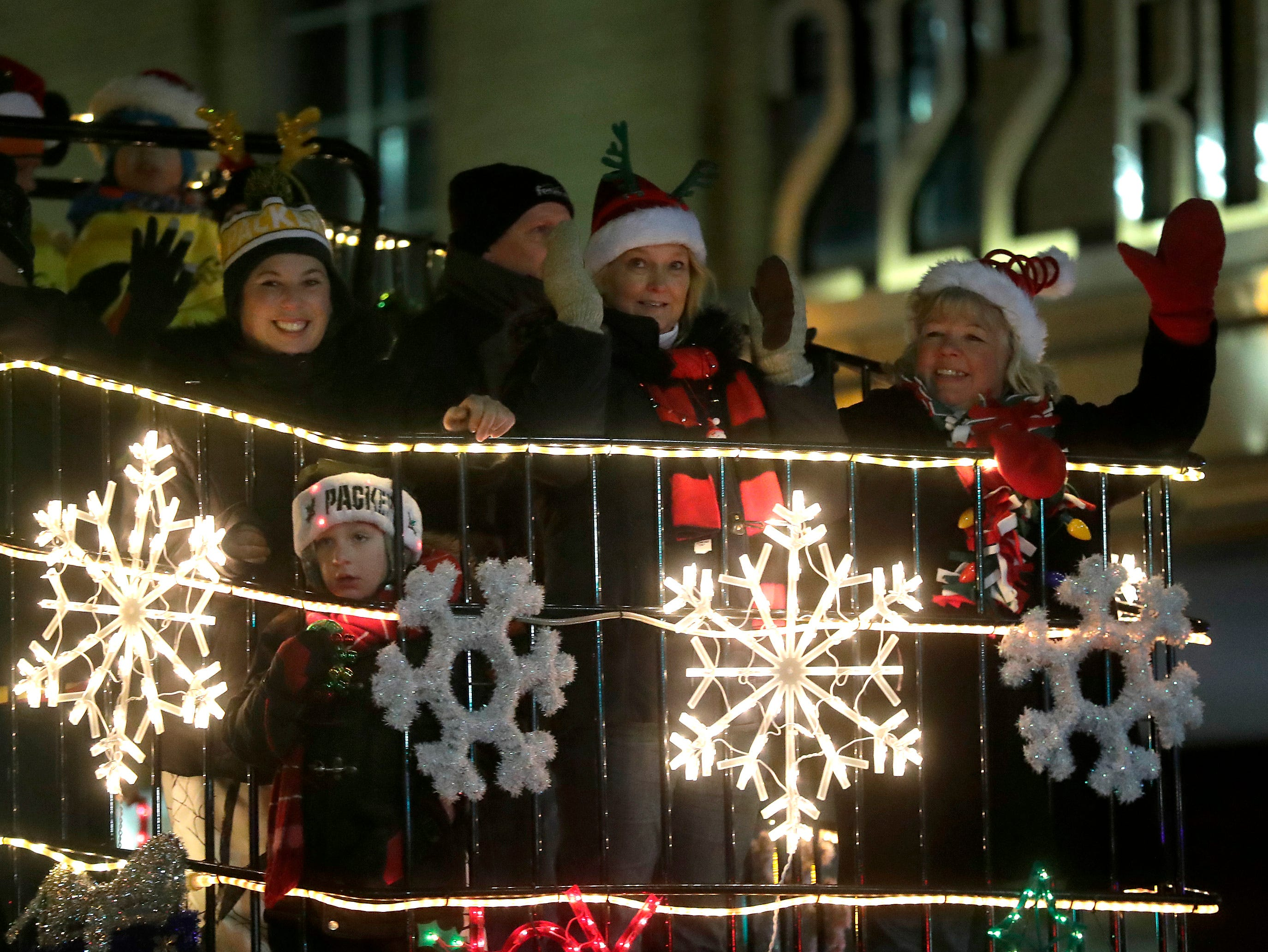 """The Festival fl;oat during the 48th Annual Downtown Appleton Christmas Parade on Tuesday, Nov. 20, 2018 in Appleton, Wis. This year's theme was """"Home for the Holidays."""" Wm. Glasheen/USA TODAY NETWORK-Wisconsin."""