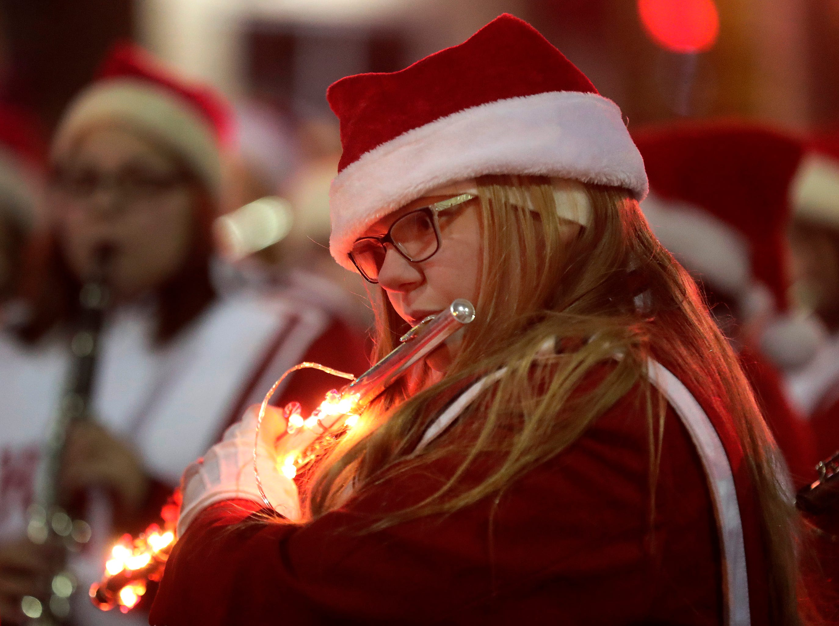 "Hortonville High School's Jennette Fredrickson plays during the 48th Annual Downtown Appleton Christmas Parade on Tuesday, Nov. 20, 2018 in Appleton, Wis. This year's theme was ""Home for the Holidays."" 