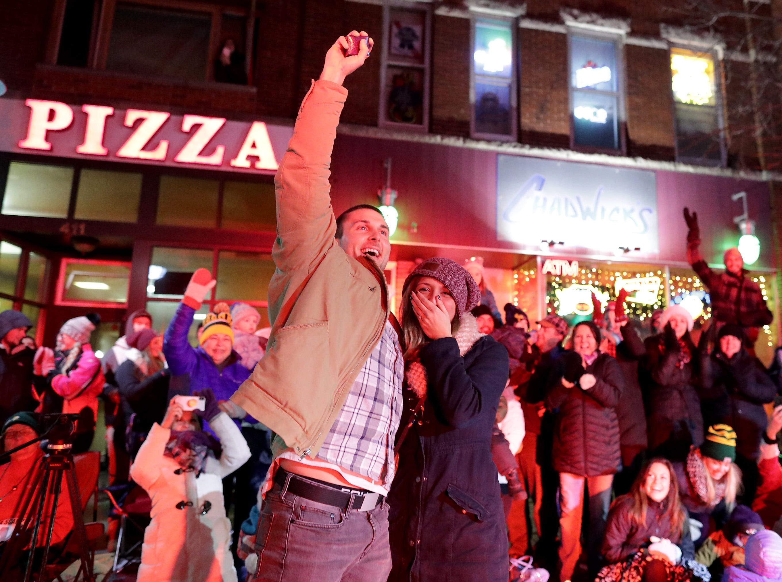 Appleton firefighter Bryce Sternhagen proposes to Appleton West teacher Samantha Cucci during the 48th Annual Downtown Appleton Christmas Parade on Tuesday, Nov. 20, 2018 in Appleton, Wis. Sternhagen left the parade to propose and she said yes. Wm. Glasheen/USA TODAY NETWORK-Wisconsin.