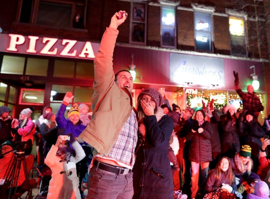 Bryce Sternhagen and Samantha Cucci celebrate their engagement Tuesday during the 48th Annual Downtown Appleton Christmas Parade.