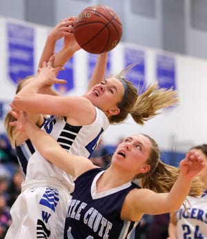 Wrightstown's Ella Diny goes for a rebound during a game against Little Chute on Nov. 20 in Wrightstown.