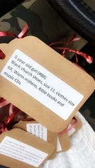 One of the gift tags which list the gifts children need.