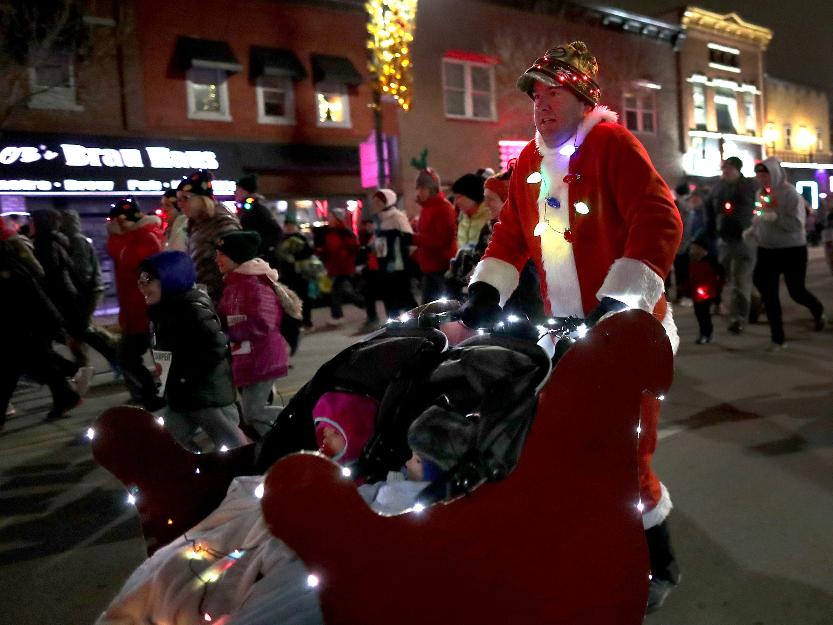"""The Santa Scamper before the 48th Annual Downtown Appleton Christmas Parade on Tuesday, Nov. 20, 2018 in Appleton, Wis. This year's theme was """"Home for the Holidays."""" Wm. Glasheen/USA TODAY NETWORK-Wisconsin."""