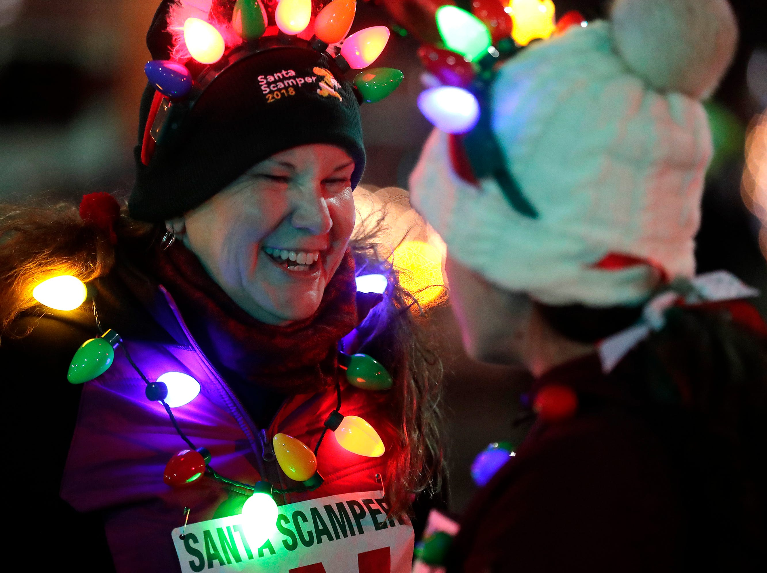 """BVarb, left, and Ellie Bigalke prepare to run the Santa Scamper before the 48th Annual Downtown Appleton Christmas Parade on Tuesday, Nov. 20, 2018 in Appleton, Wis. This year's theme was """"Home for the Holidays."""" Wm. Glasheen/USA TODAY NETWORK-Wisconsin."""