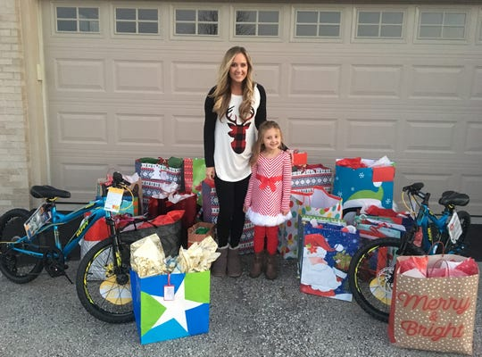 Kendra and Avaya Conard with some of the presents that will be delivered to foster children throughout the county.