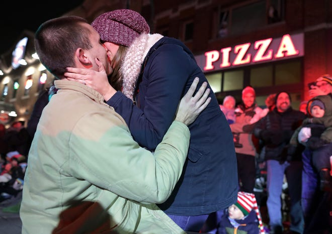 Appleton firefighter Bryce Sternhagen and Appleton West teacher Samantha Cucci kiss after she accepted his marriage proposal during the 48th Annual Downtown Appleton Christmas Parade.