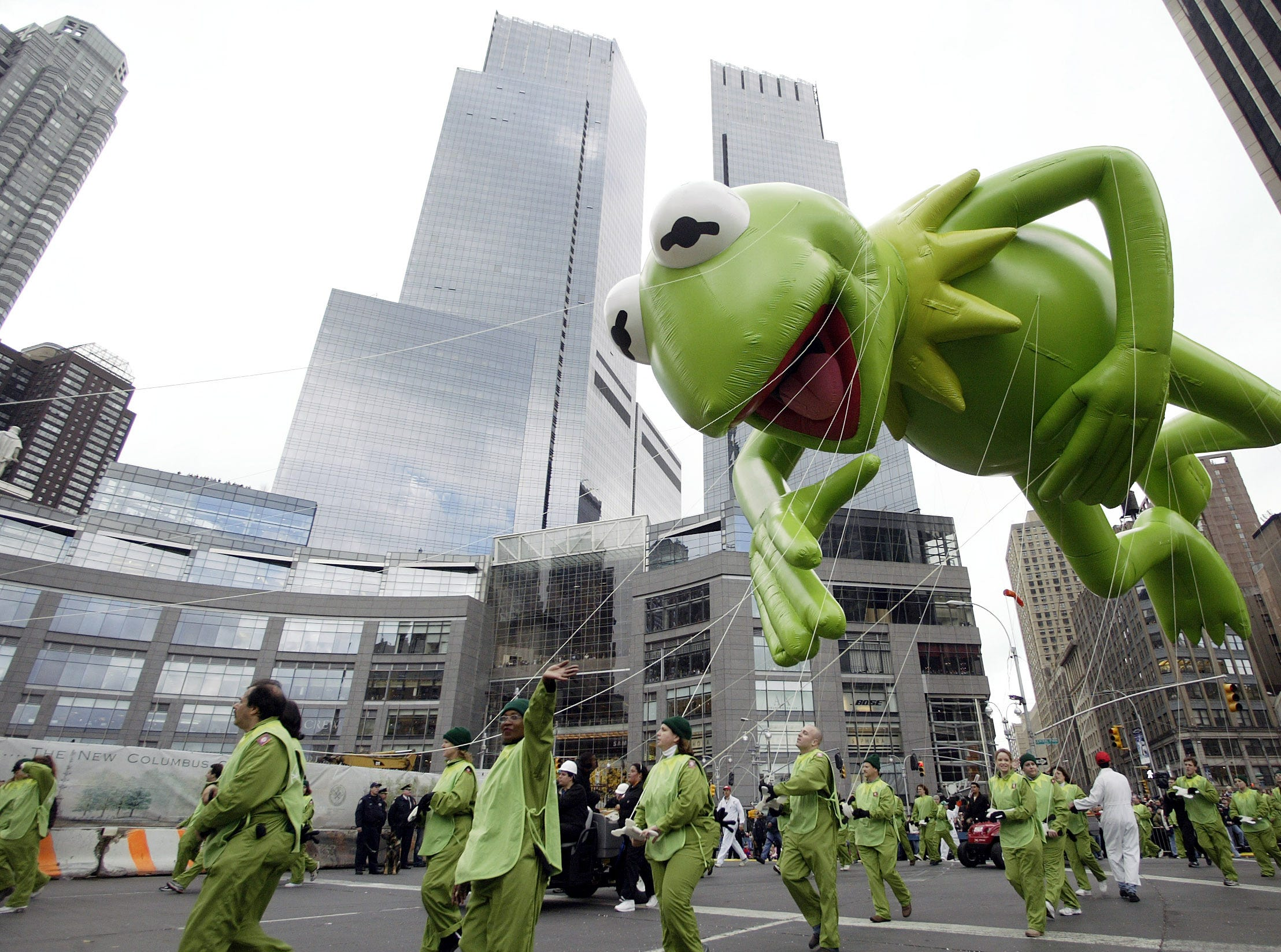 Kermit the Frog floats above the newly renovated Columbus Circle during the Macy's Parade in New York, Thursday, Nov. 25, 2004. The Thanksgiving Day parade, featuring 59 balloons and 27 floats, stepped off just after 9 a.m. and began its procession toward Herald Square in Manhattan. (AP Photo/Gregory Bull)