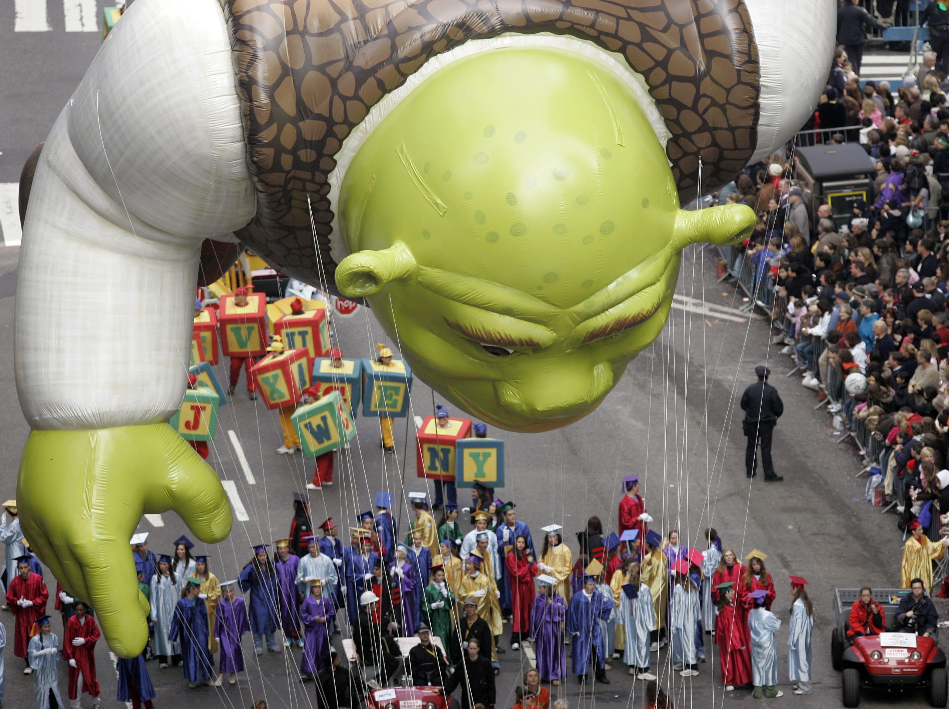 The Shrek balloon floats down Broadway during the Macy's Thanksgiving Day parade in New York, Thursday, Nov. 22, 2007.  (AP Photo/Jeff Christensen)