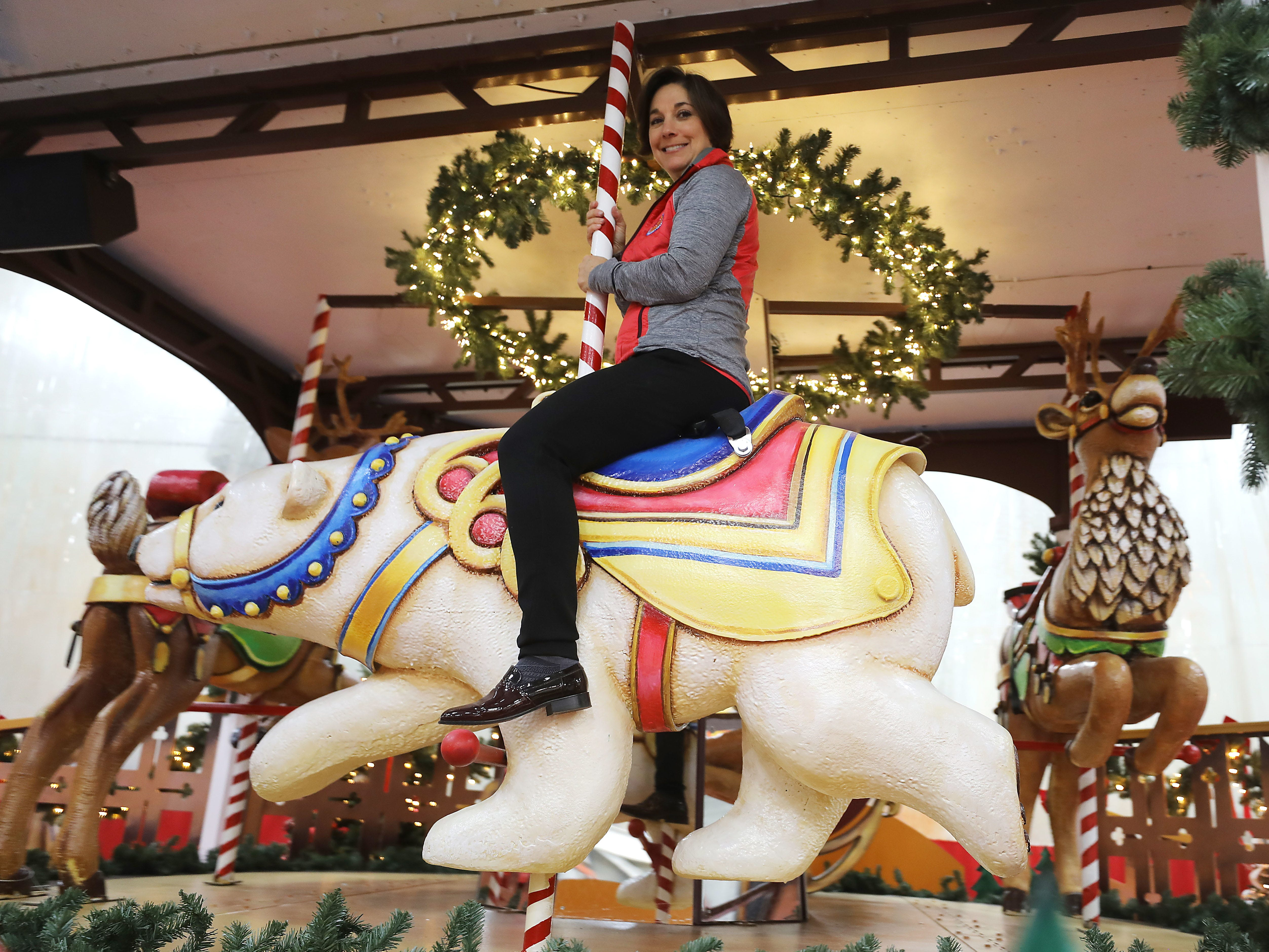 """CHRIS PEDOTA A polar bear character is part of the new Balsam Hill """"Deck the Halls"""" float. Amy Kule, vice president of Macy's Parade and Entertainment Group, on a polar bear figure that is part of the new Balsam Hill """"Deck the Halls"""" float"""