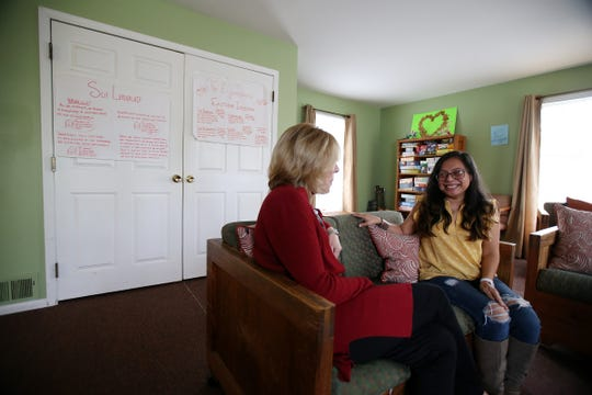 Maureen Kale (left), director of residential programs for Collier Youth Services, speaks with Nancy Nicolas, a former resident and current treatment counselor, at Collier Group Home in Red Bank.