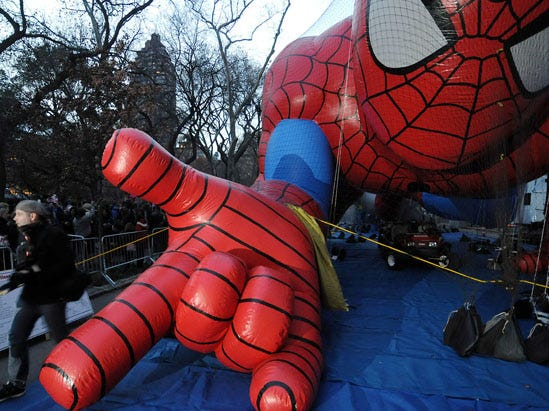 73710 - NEW YORK - 11/24/10 - INFLATING MACYS BALLOONS - Spiderman gets close to the crowd. The Macys balloons are being inflated on 81st Street near Central Park West for the Thanksgiving Day parade in Manhattan. DAVID BERGELAND / STAFF PHOTOGRAPHER