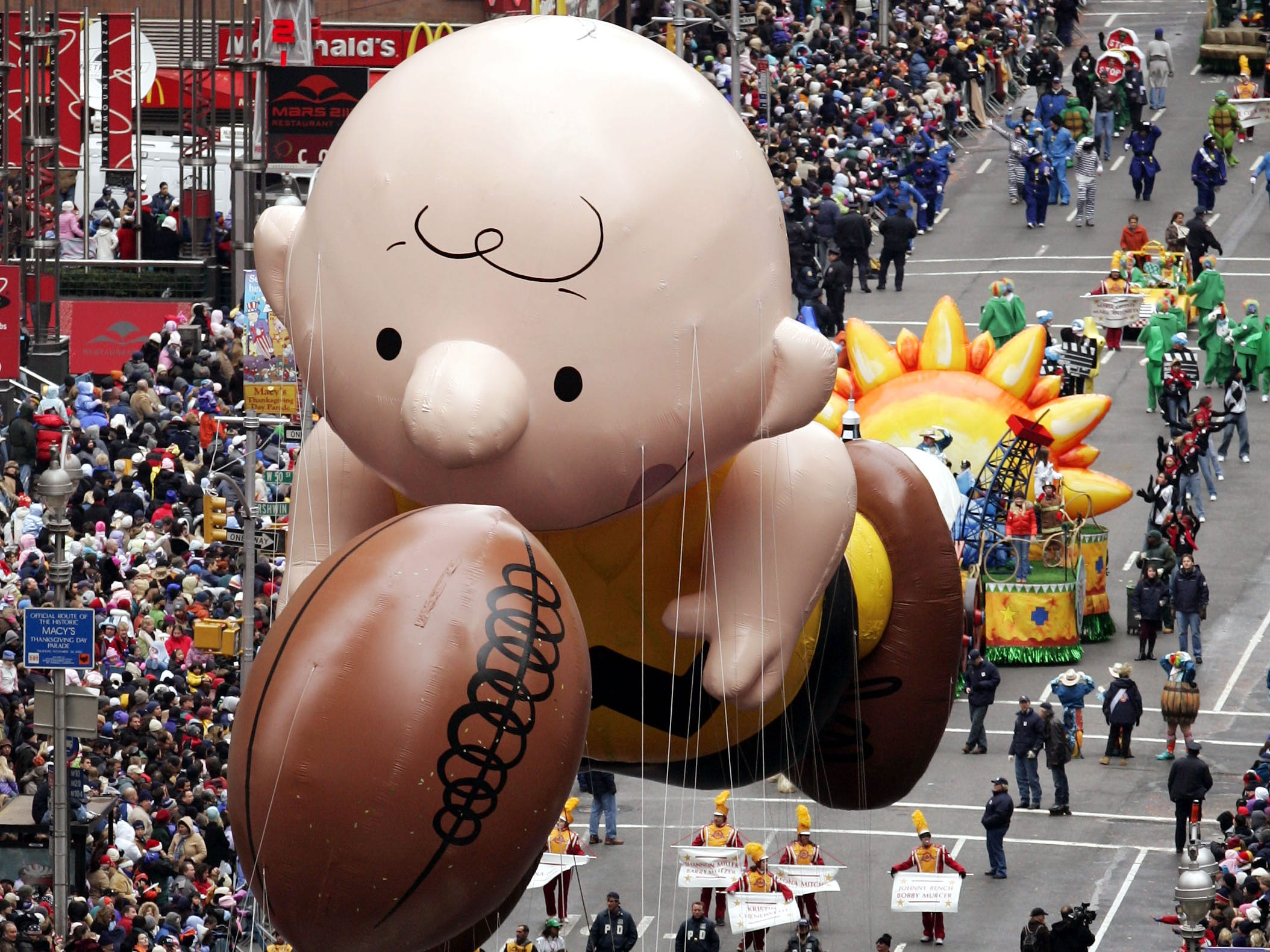 FILE - This Nov. 24, 2005 file photo shows a balloon of Peanuts character Charlie Brown chasing a football down Broadway during the Macy's Thanksgiving Day parade in New York.   (AP Photo/Jeff Christensen, file)