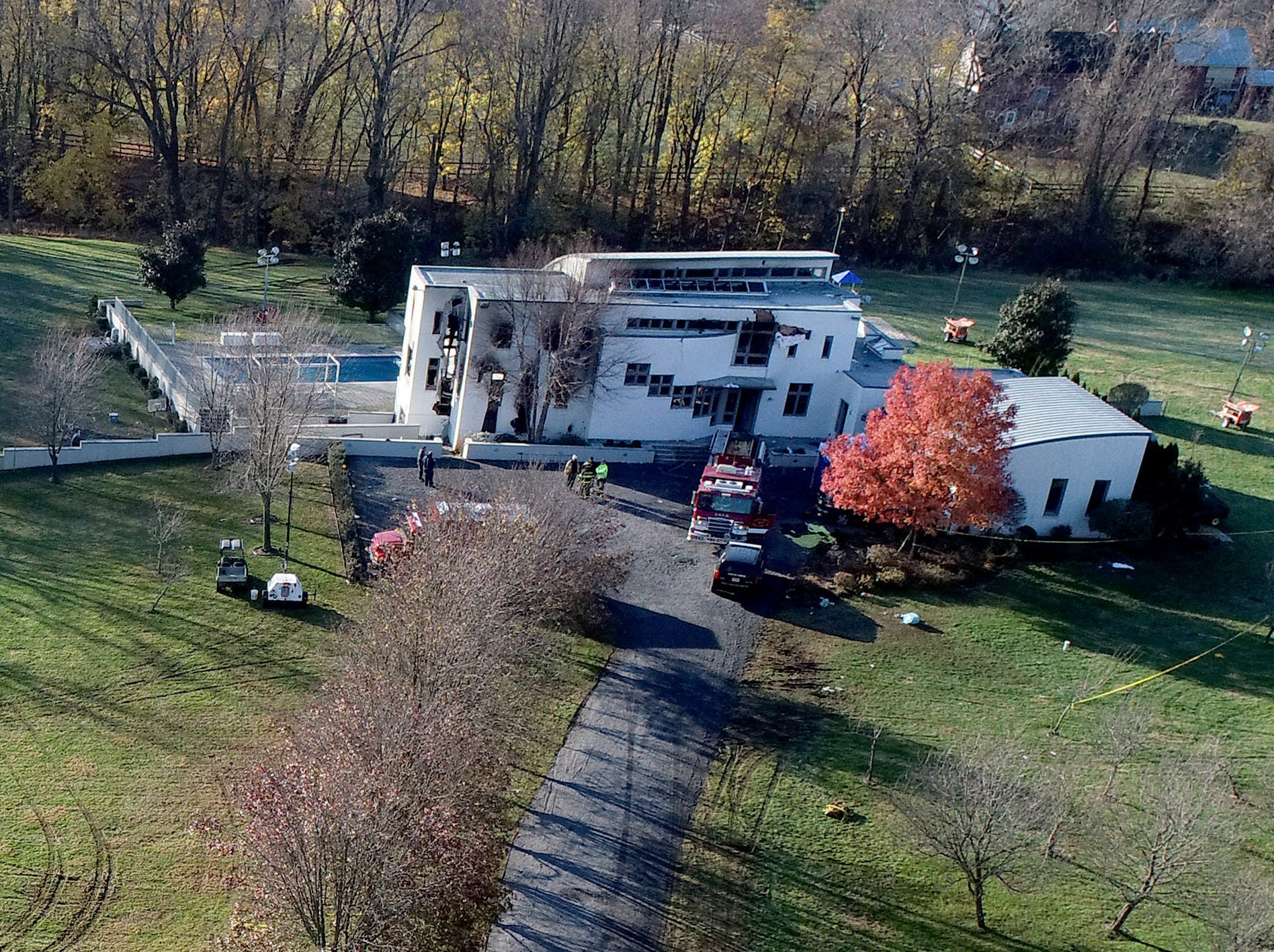 The investigation continues Wednesday morning, November 21, 2018, at the scene of a fire at 15 Willow Brook Road in Colts Neck that left four people dead