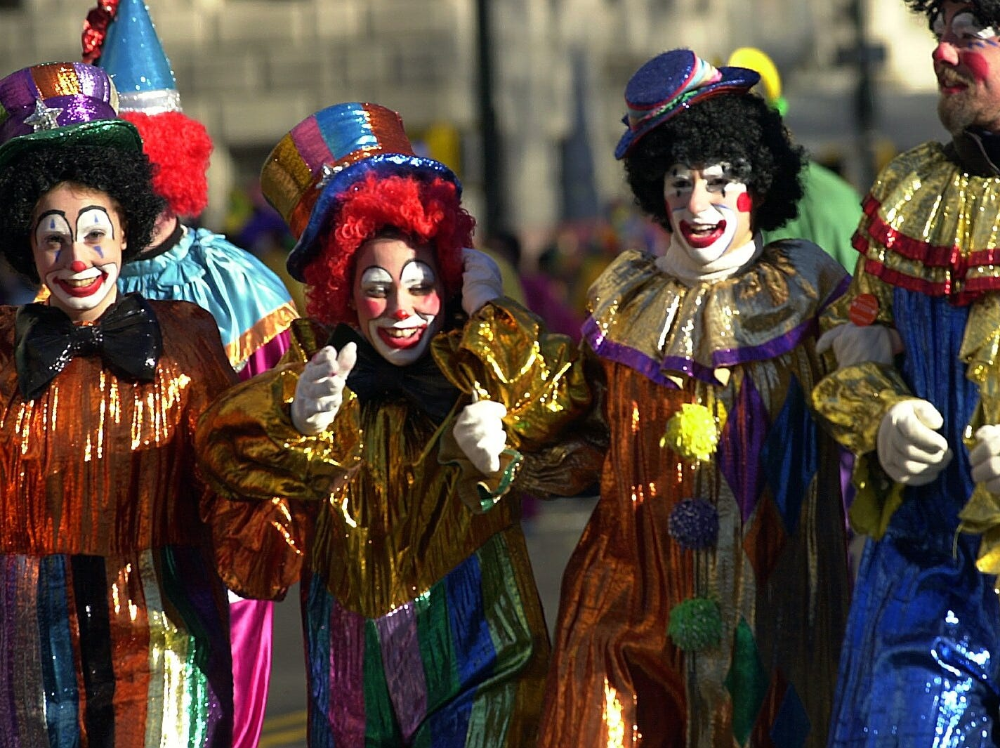 -  -Clowns of all sizes and colors warmed up the parade route Thursday at the Macy's Thanksgiving Day Parade. (Carmen Troesser / The Journal News 11/23/00)