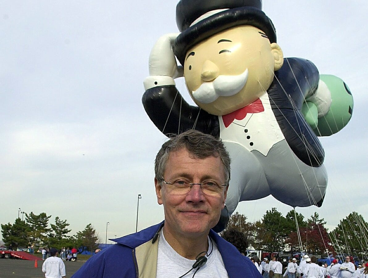 """-  -Robin Hall, Macy's Parade Director poses in front of the new """"Mr. Monopoly"""" balloon during its test flight in East Rutherford, NJ on Saturday, November 9, 2002. (Rohanna Mertens for The Journal News11/09/02)"""
