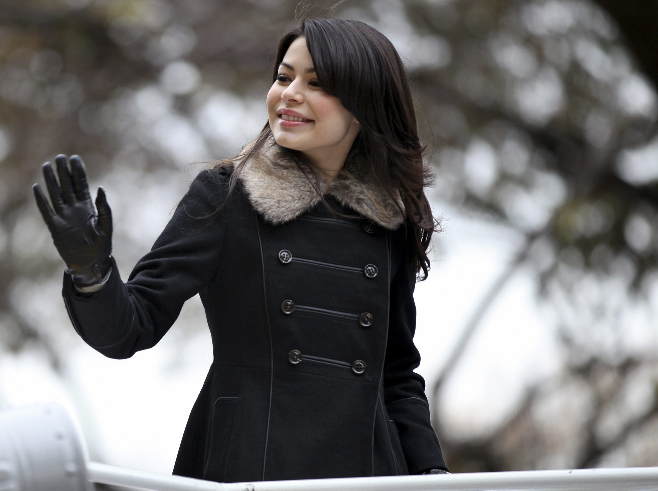 Actress and singer Miranda Cosgrove waves as she rides by on a float during the Macy's Thanksgiving Day Parade in New York Thursday, Nov. 25, 2010.  (AP Photo/Craig Ruttle)
