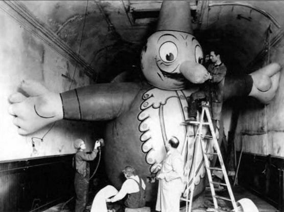 Puppeteer Tony Sarg (on ladder) touches up one of the balloons for the Macy's Thanksgiving Day Parade. Provided/Macy's