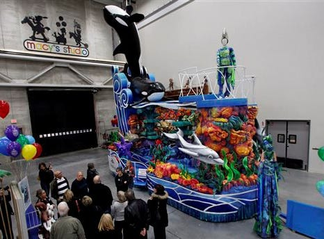 People view Seaworld's A Sea of Surprises float during a preview of new Macy's Thanksgiving Day Parade floats in Moonachie, N.J., Tuesday, Nov. 19, 2013. (AP Photo/Mel Evans)