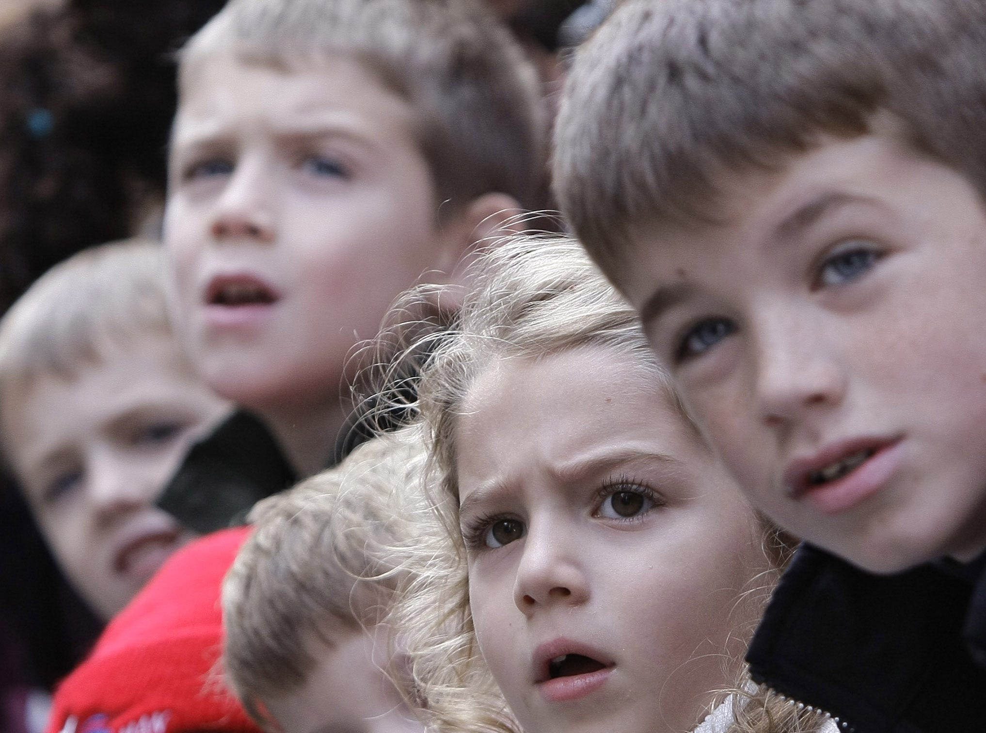 Children watch as the Shrek balloon passes by on Broadway during the Macy's Thanksgiving Day parade Thursday, Nov. 22, 2007 in New York. (AP Photo/Julie Jacobson)