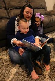Melissa Catalano reads to her son Jaxson and daughter Ella