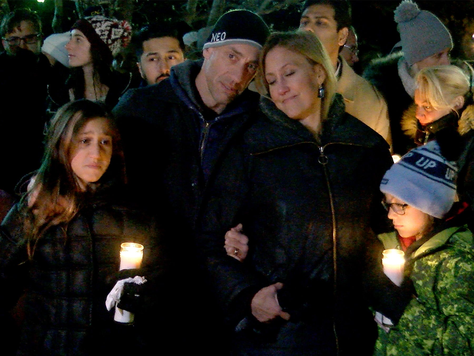 People gather outside the Colts Neck Town Hall Wednesday night, November 21, 2018, for a vigil to remember the Caneiro family killed in a house fire the previous day.