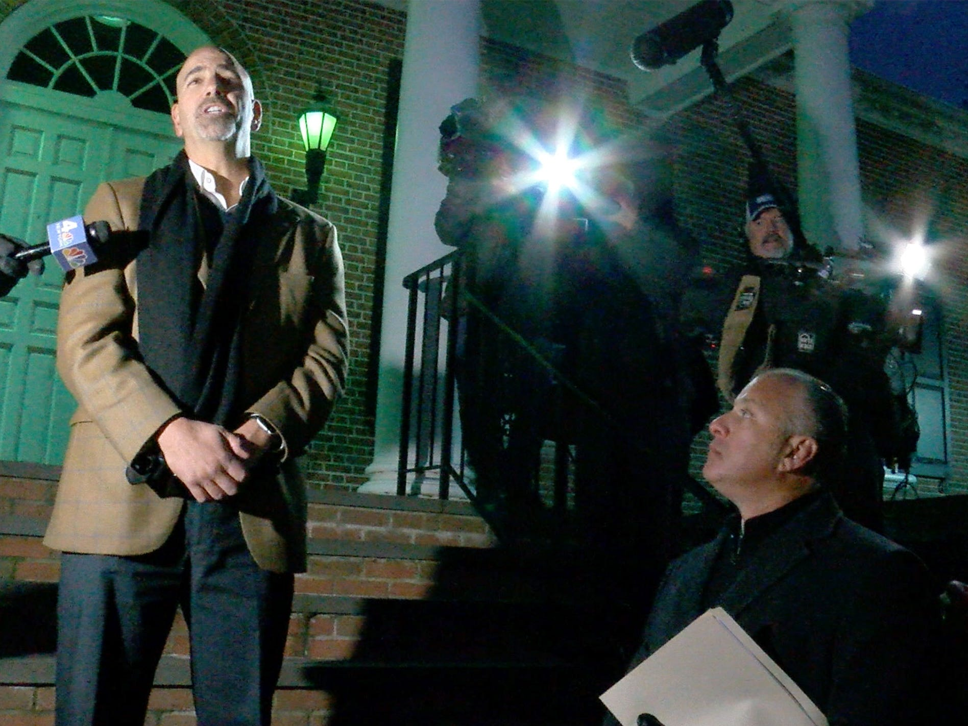 Colts Neck Mayor J.P. Bartolomeo speaks from the steps of Town Hall Wednesday night, November 21, 2018, for a vigil to remember the Caneiro family killed in a house fire the previous day.