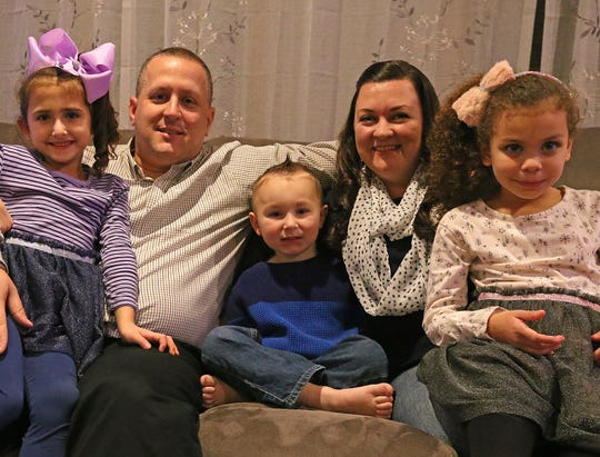 Melissa and Joseph Catalano have three adopted children, daughters Ella, left, and Olivia, both 6, and son Jaxson, 4.