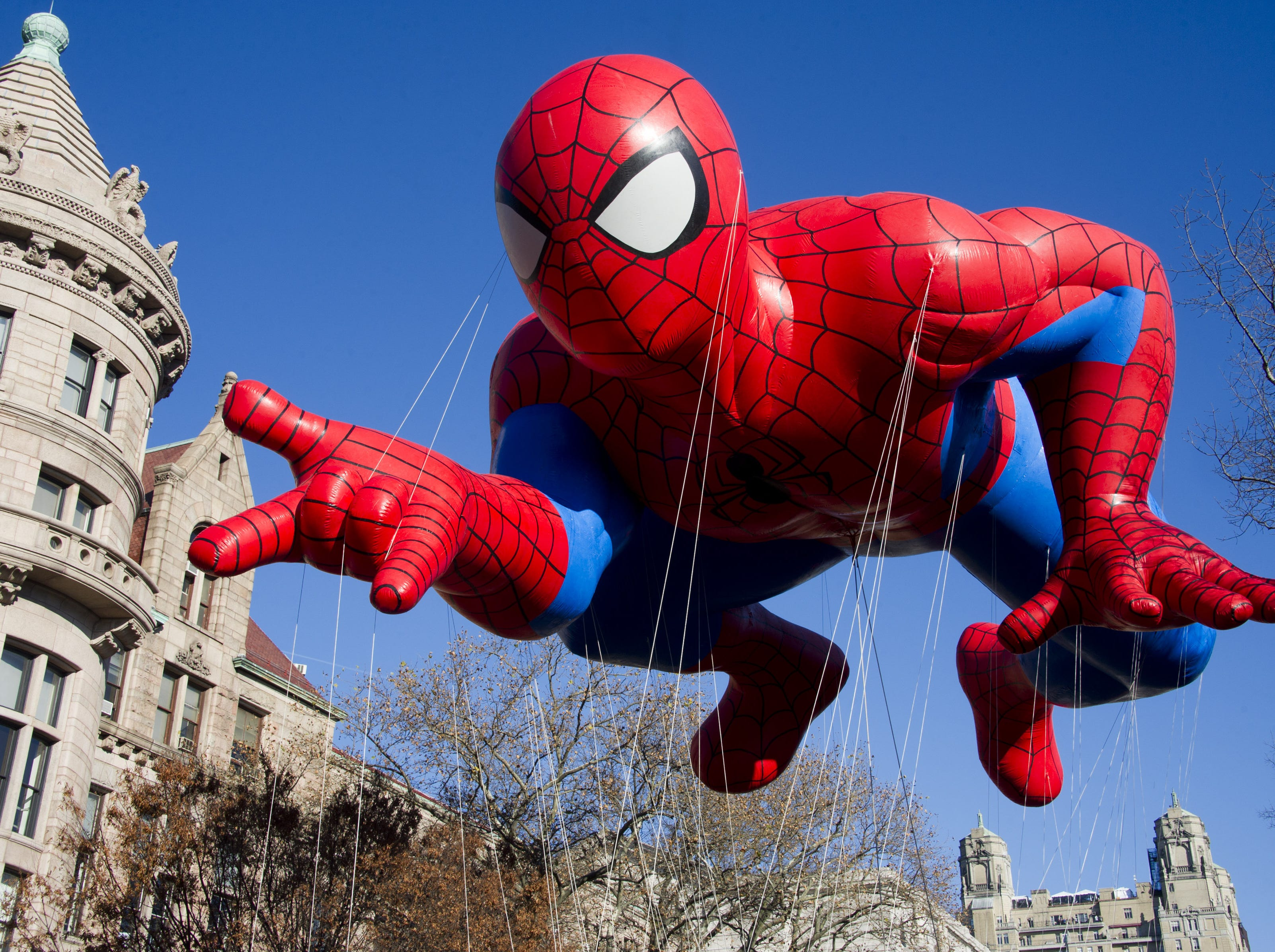 The Spider-Man balloon during last year?s Macy?s Thanksgiving Day Parade. AP file photo/Charles Sykes FILE - This Nov. 24, 2011 file photo shows the Spider-Man balloon during the Macy's Thanksgiving Day Parade in New York. The parade has to be a crowd-pleaser for a multigenerational crowd. More than 3 million people typically attend the event that also unfolds in front of a TV audience of 50 million. This year's parade will feature balloons include Papa Smurf and the Elf on a Shelf, while Buzz Lightyear, Sailor Mickey Mouse and the Pillsbury Doughboy keep their place in the lineup. A new version of Hello Kitty is also to be included. (AP Photo/Charles Sykes, file)