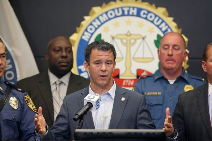 Monmouth County Prosecutor Christopher Gramiccioni reveals details in the Colts Neck quadruple murder and arson fire during a press conference in at the Monmouth County Prosecutor's Office in Freehold, NJ Wednesday November 21, 2018. Behind him stand (L-R) Monmouth County Assistant Prosecutor Christopher Decker, Ocean Township Chief of Police Steven Peters, Monmouth County Deputy Chief of Detectives Douglas Johnson, Colts Neck Police Chief Frank Leccese, Monmouth County Sheriff Shaun Golden and Monmouth County Chief of Detectives John G. McCabe, Jr.