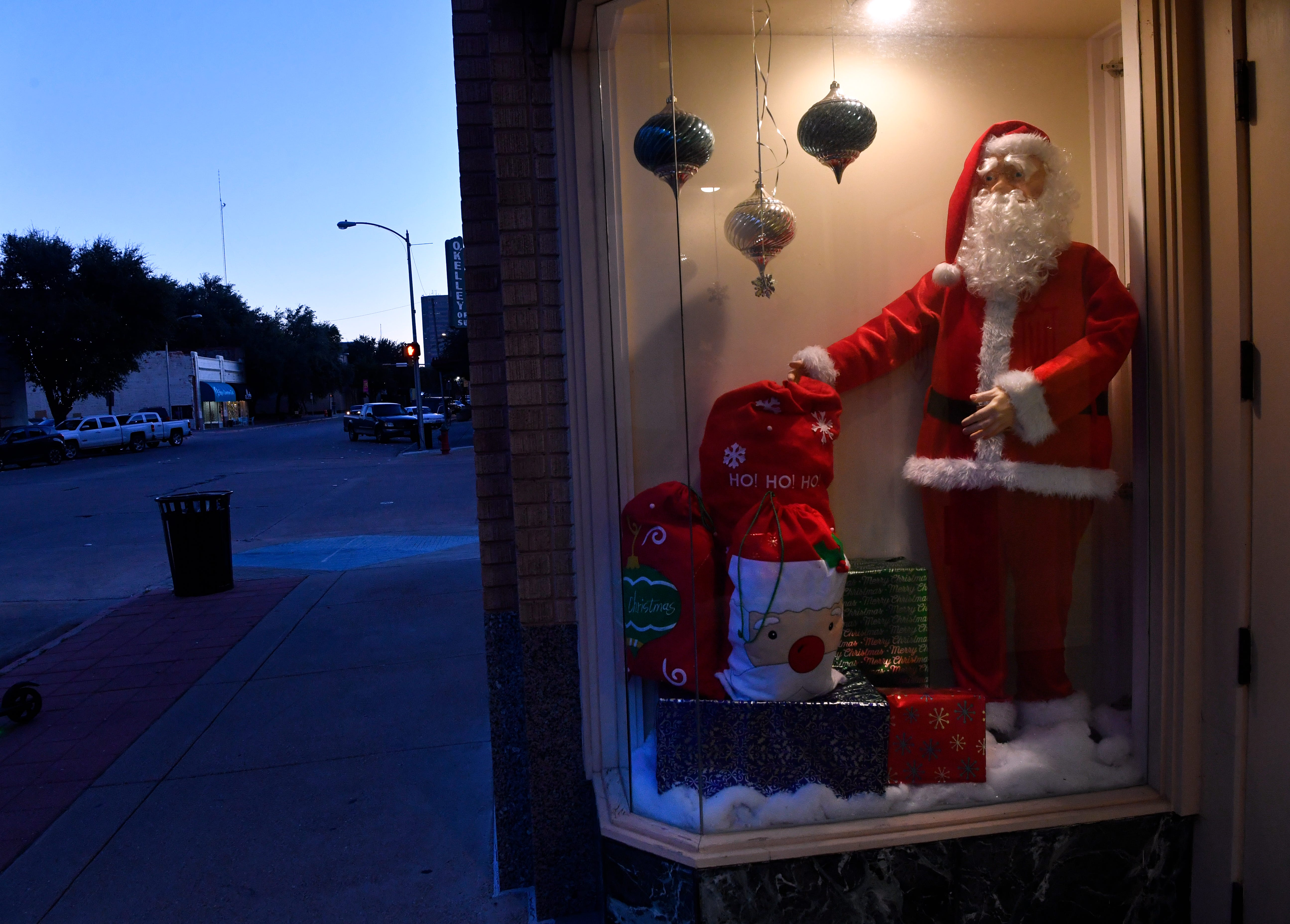 A Santa Claus figure stands on display in a window at Hotel Wooten Tuesday.