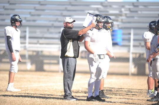 Haskell football coach Brian Hodnett instructs players during practice Nov. 20, 2018. The Indians were preparing for a second-round playoff against Wheeler.