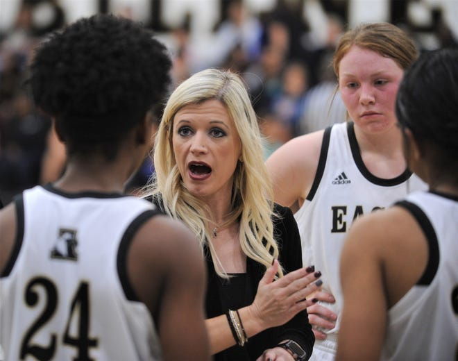 Abilene High coach Terri Aston talks to her team during a break in the Lady Eagles' game against Cooper. AHS beat the Lady Coogs 38-35 in the nondistrict girls basketball game Nov. 20, 2018, at Eagle Gym.