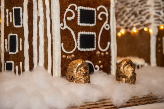 The lions at the front of the Biltmore gingerbread house are made of chocolate and painted with real gold. Nov. 2, 2018.