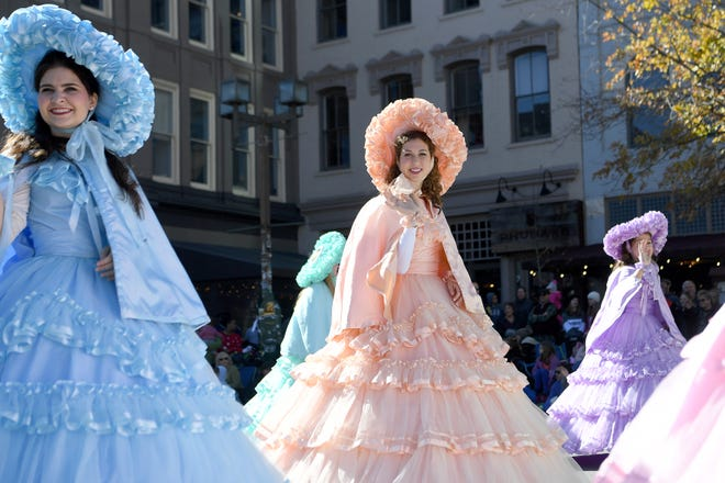 More than 100 entries walked the streets of downtown packed with spectators in the 2018 Asheville Holiday Parade on Nov. 17, including 12 girls in pastel-colored hoop skirts. They were from the Dogwood Trail Court, sponsored by the Eastern Shore Optimist Club in Alabama.