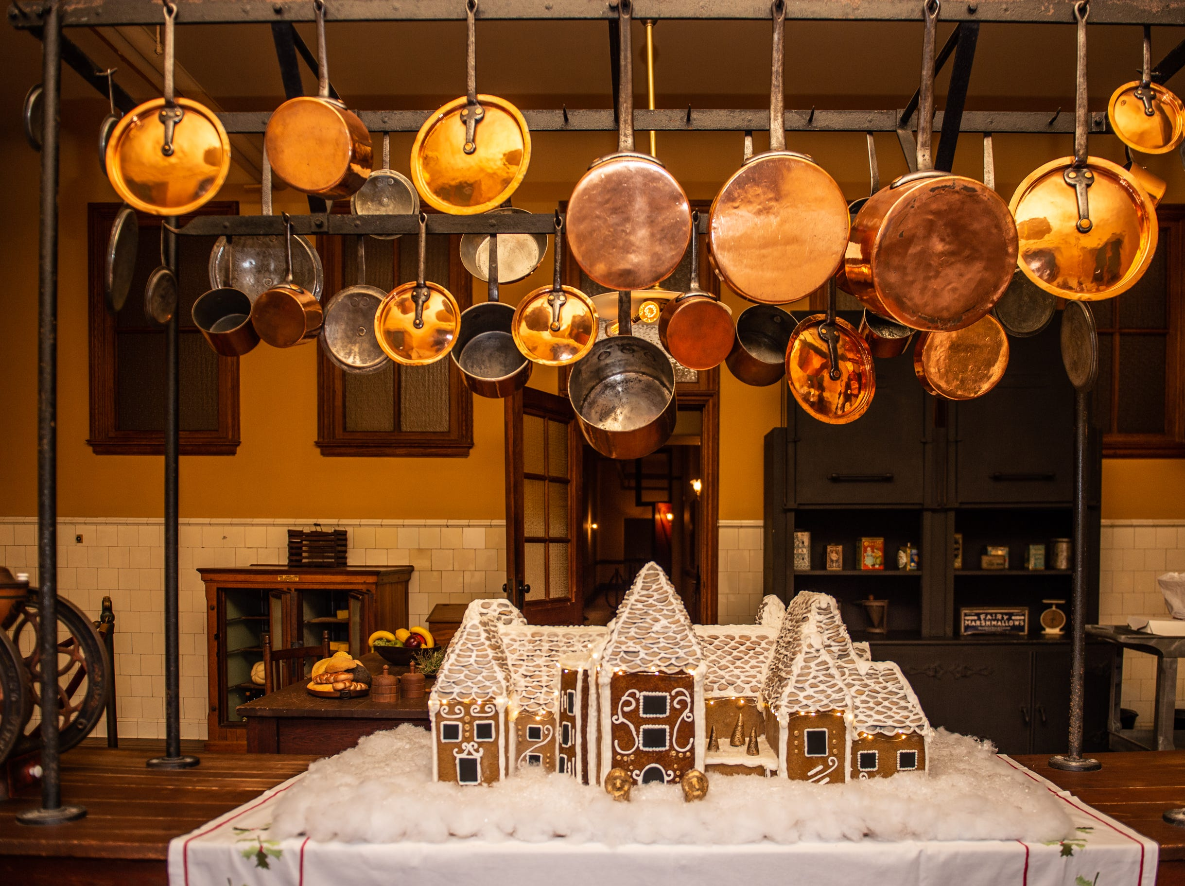 The completed gingerbread house sits in the Biltmore Estate kitchen the morning of Nov. 2, 2018. The annual edible construction is supported by a skeleton in the general shape of Biltmore House that is used year after year.