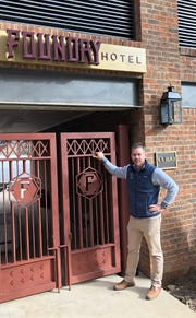 David Tart, a partner in Encore Lodging, stands outside The Foundry Hotel, 51 S. Market St. in Asheville, near the public entrance to the hotel off Market Street.