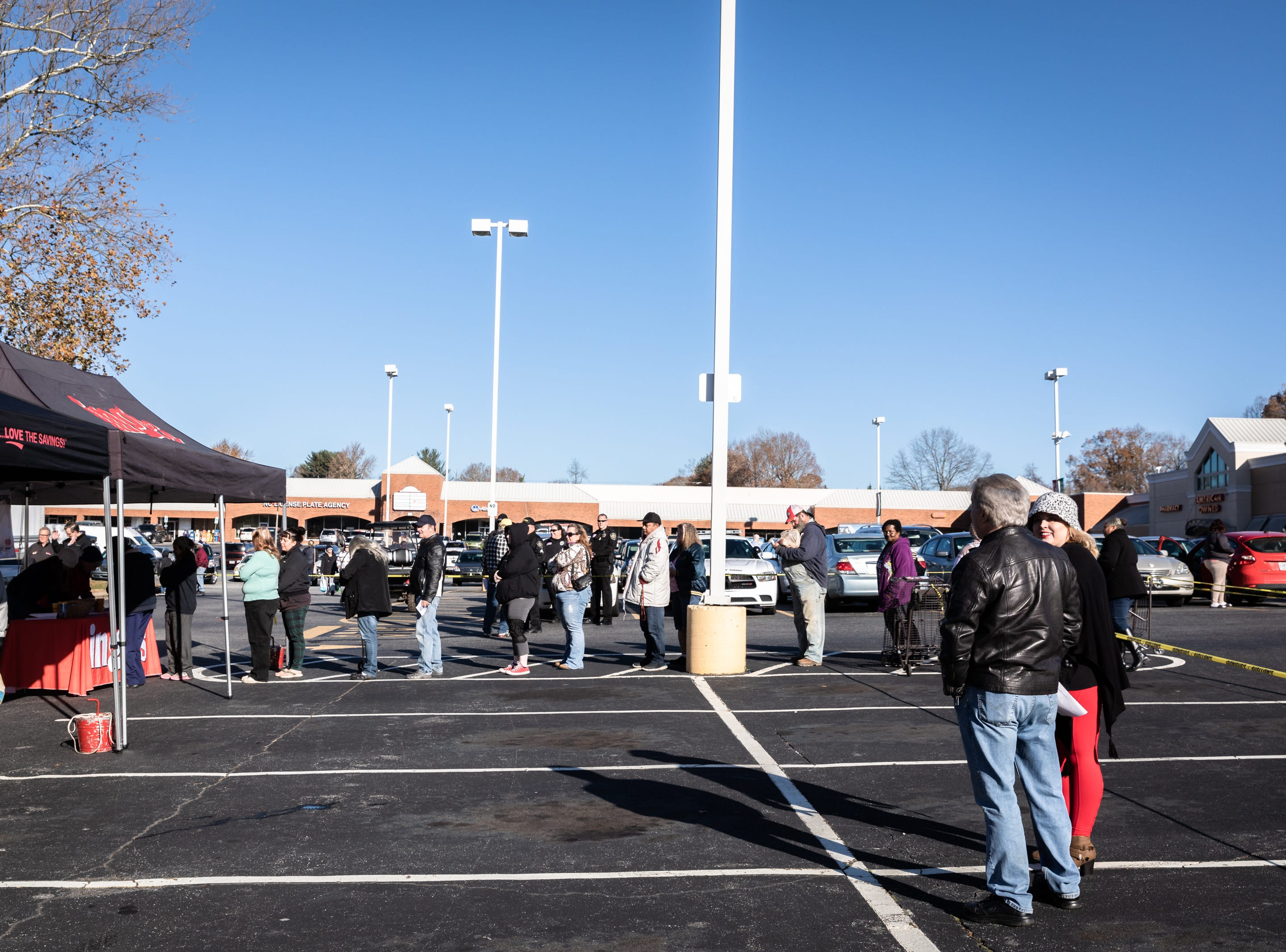 Clients of Eblen Charities line up to receive Thanksgiving meals at Ingles in the South Forest Shopping Center, during their annual turkey giveaway Nov. 21, 2018. More than 13,000 meals were provided to nearly 1,300 families this year.
