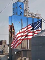 A rendering by artist Matthew Sharum of the planned Veterans mural on the grain elevator on 772 E. Emmett St. in Battle Creek.
