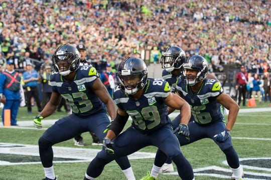 The Seahawks receiving corps celebrates following a touchdown against the Chargers at CenturyLink Field on Nov. 4. They include, from left, David Moore, Doug Baldwin, Jaron Brown and Tyler Lockett.