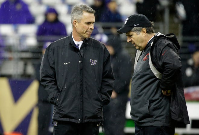 Washington's Chris Petersen, left, and Washington State's Mike Leach are about as different as they can be. But both have led their schools to unprecedented success.