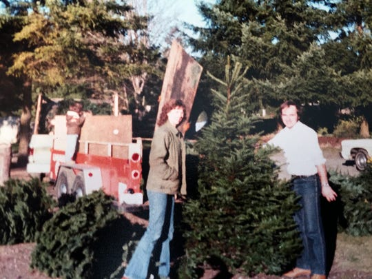 Paul and Vivian Olmsted first sold Christmas trees door to door when they started the family's tree business.