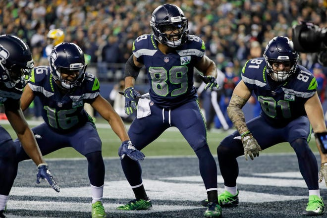 The Seattle Seahawks receiving corps -- including, from left, Tyler Lockett (16), Doug Baldwin (89) and Nick Vannett (81) celebrate Baldwin's touchdown against the Green Bay Packers on Nov. 15.