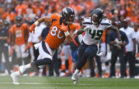 Shaquem Griffin of the Seahawks tackles Broncos tight end Jake Butt during a Sept. 9 game  in Denver.