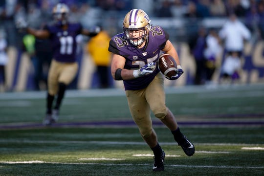 Huskies linebacker Ben Burr-Kirven returns an interception during a game against Colorado this season in Seattle. Burr-Kirven likely will finish the 2018 season with more tackles in a season than any Husky in nearly 30 years.
