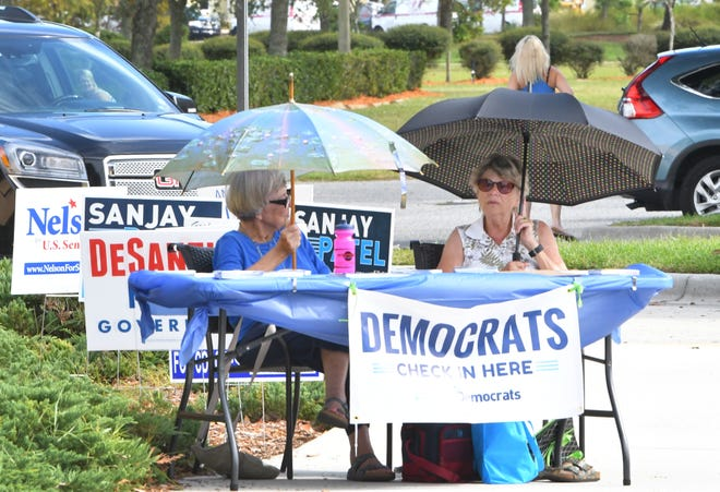 Barbara Kurtz and Harriet Boggi staff the Democratic Party table outside the polling place the Church at Viera on Election Day.