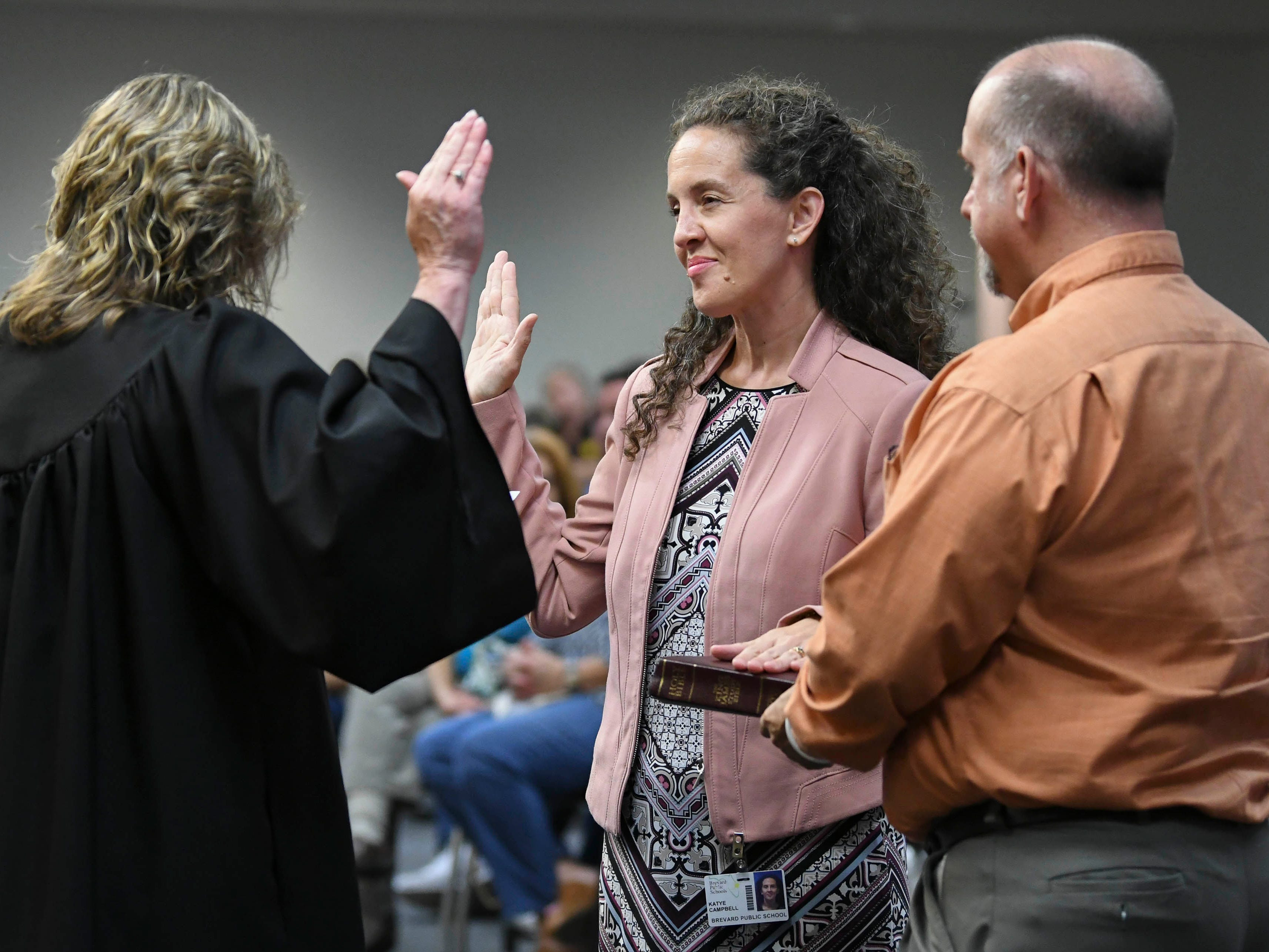 Judge Kelly McKibben swears in Katye Campbell as a new member of the Brevard County School Board during Tuesday's meeting in Viera.