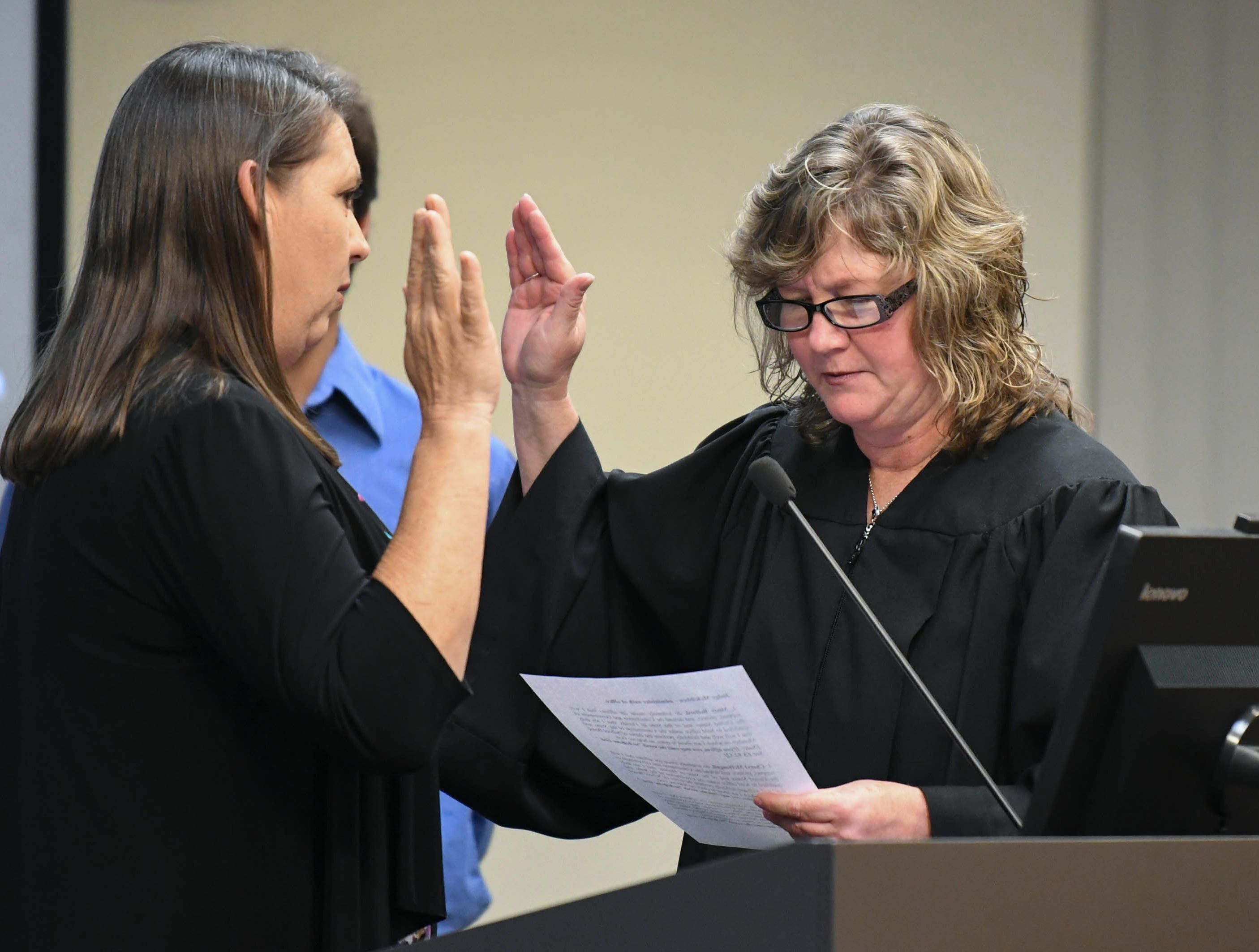 Judge Kelly McKibben swears in Misty Belford as a returning member of the Brevard County School Board during Tuesday's meeting in Viera.