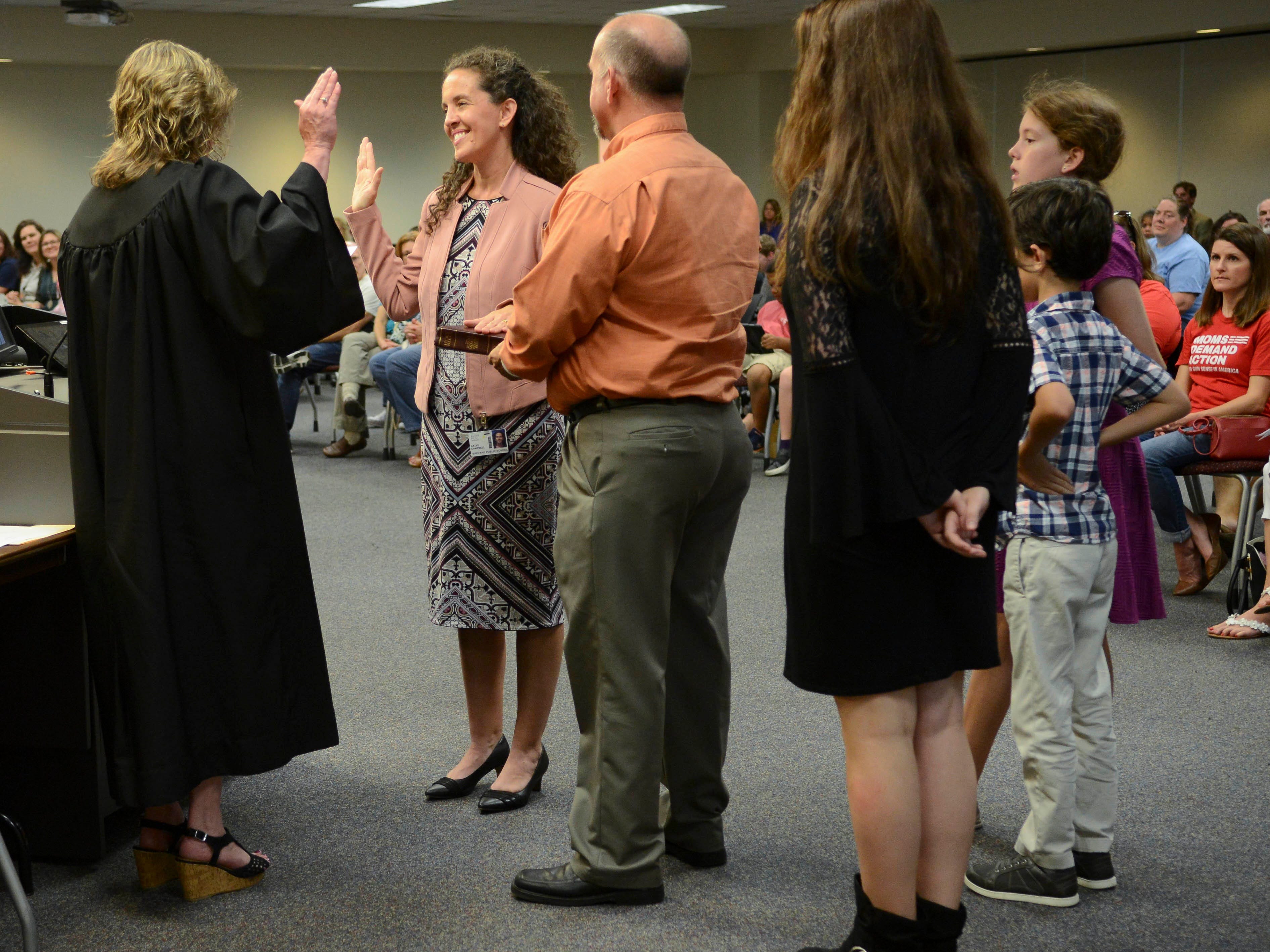 As family members watch, Judge Kelly McKibben swears in Katye Campbell as a new member of the Brevard County School Board during Tuesday's meeting in Viera.