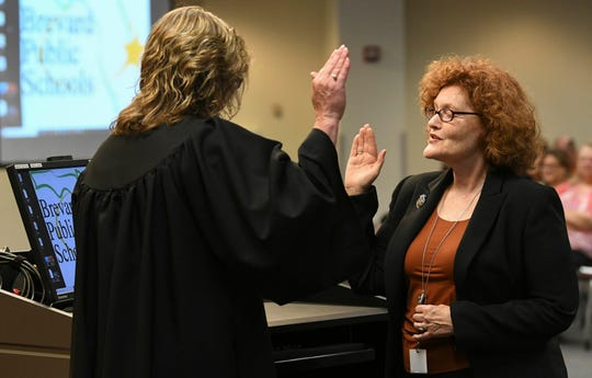 Judge Kelly McKibben swears in Cheryl McDougall as a new member of the Brevard County School Board during Tuesday's meeting in Viera.
