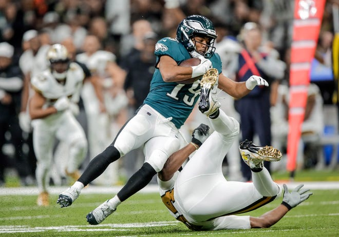 Eagles receiver Golden Tate (19) is tackled by Saints defensive end Cameron Jordan during Sunday's loss.